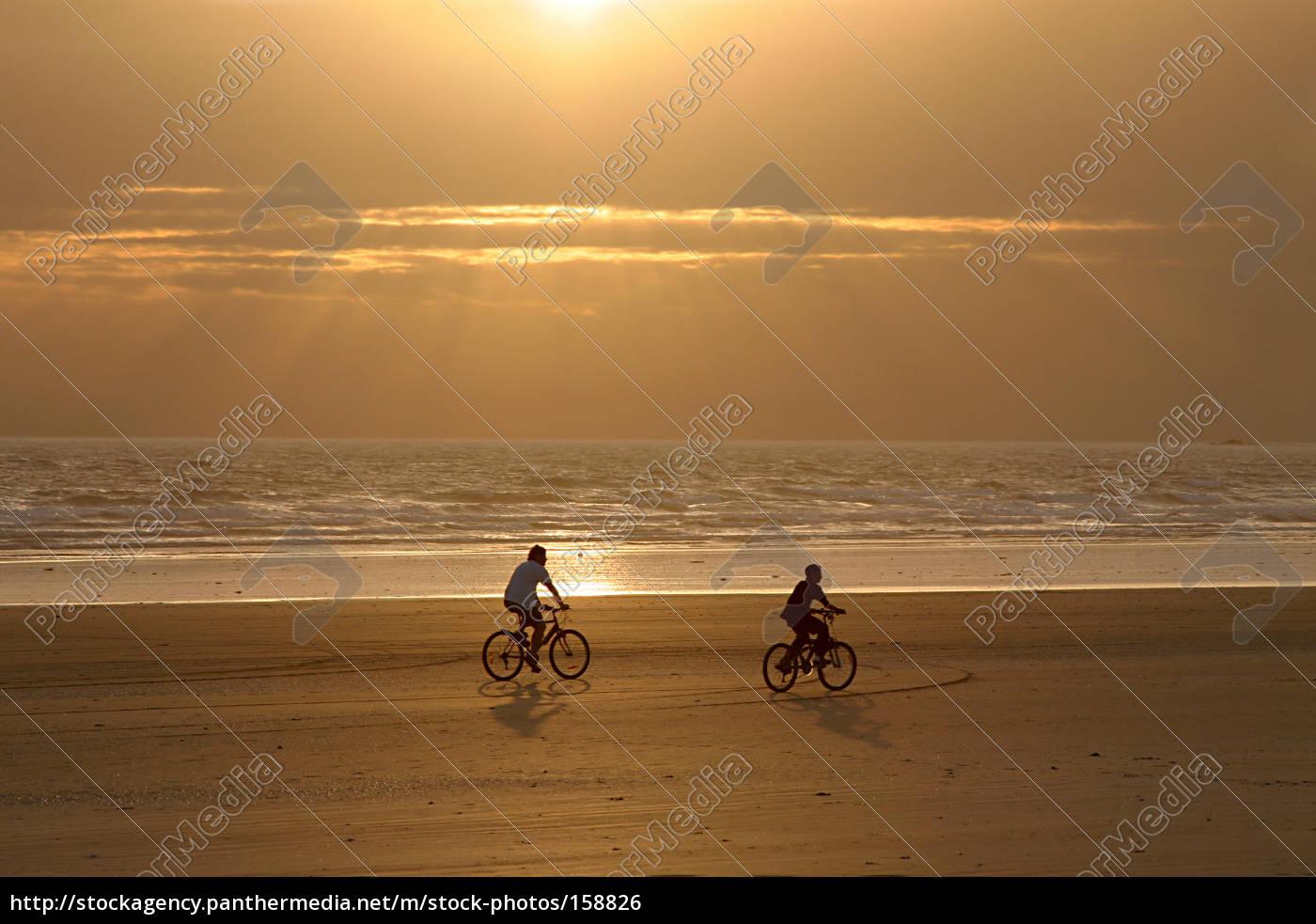 cyclists, on, the, beach - 158826