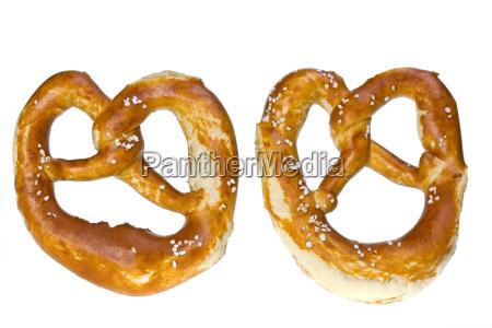 two bavarian pretzels isolated on white