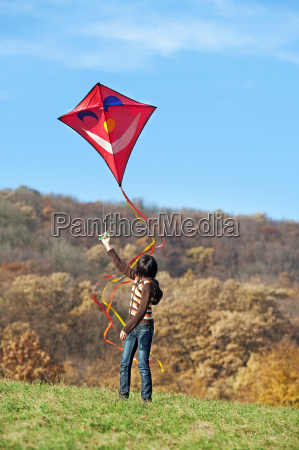 kite flying in autumn