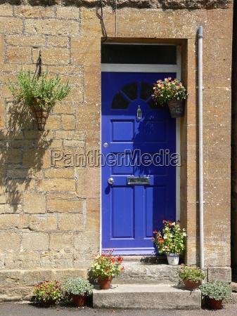 blue house building entrance door welcome