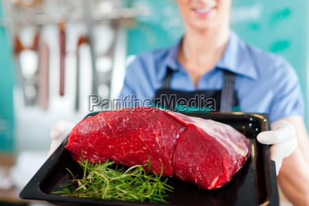working in a butcher or butcher