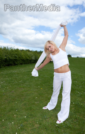 pretty young blonde stretching arms