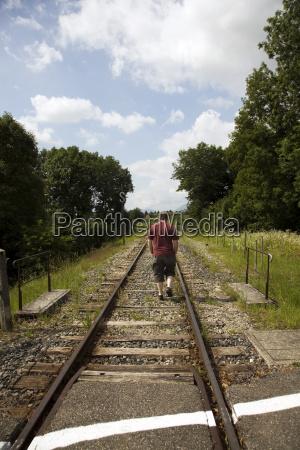 man following tracks