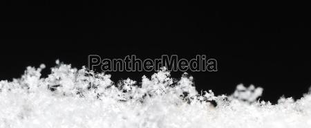 schneekristalle panorama schwarz