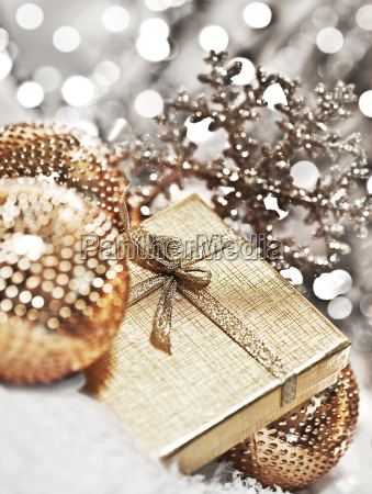 silver christmas gift with baubles decorations