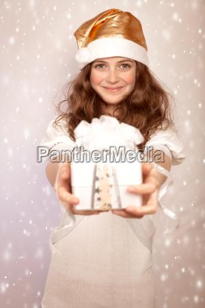 santa girl offers gift box