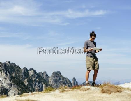 a hiker on the mountain summit