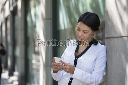 business people outdoors keeping in touch
