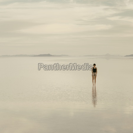 woman standing on the flooded bonneville