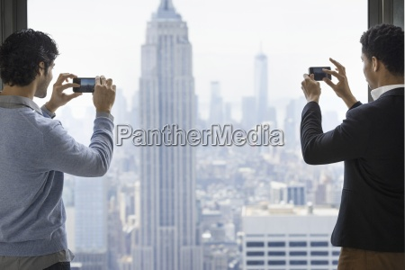 urban lifestyle two young men using