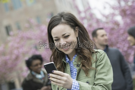a young woman checking her smart