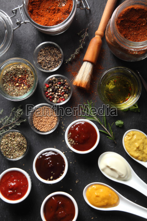 assorted seed type spices and sauces