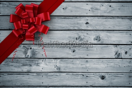 composite image of red christmas bow