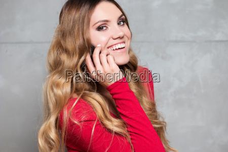 beautiful woman in red dress talks