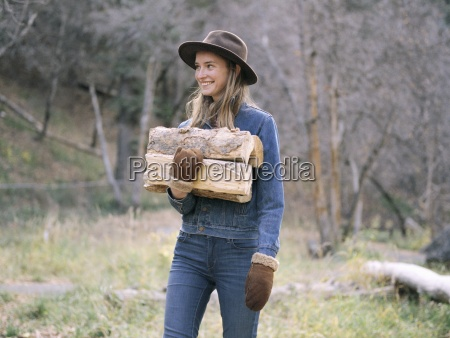 young blond woman wearing a hat