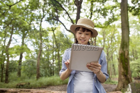 young woman holding a digital tablet