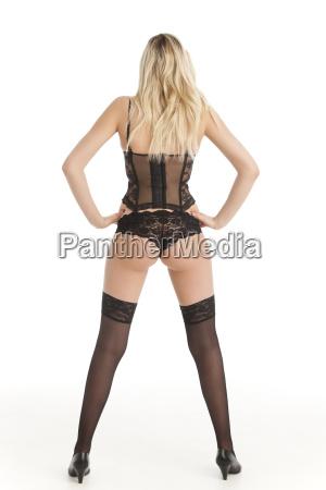 blonde frau in unterwaesche von hinten