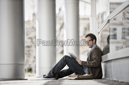 a man sitting outside a building