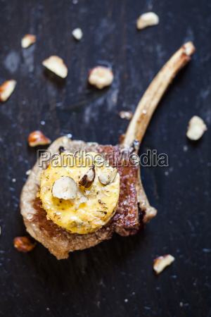 slice of compound butter with hazelnuts