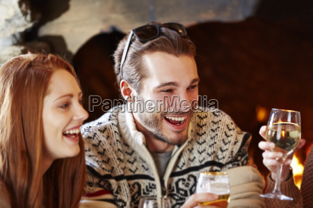 couple enjoying drinks with friends