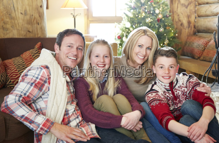 family sitting in living area together