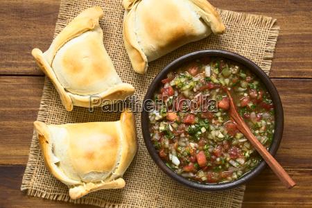 chilean pebre sauce with empanadas
