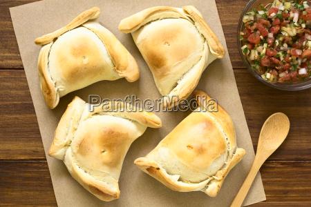 chilean empanada with pebre sauce