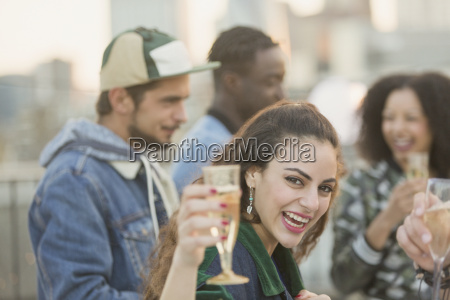 portrait enthusiastic young woman drinking champagne