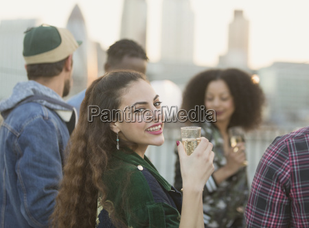 portrait smiling young woman drinking champagne