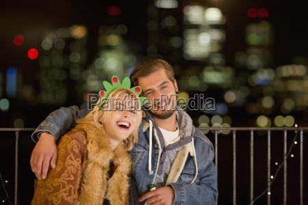 portrait smiling young couple enjoying nighttime