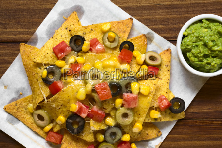 baked nachos with cheese and vegetables