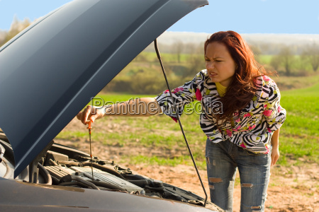 young, woman, bent, over, car, engine - 19385404