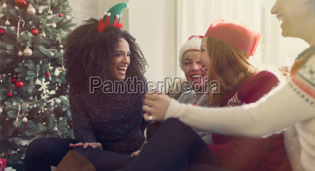 friends talking and laughing near christmas