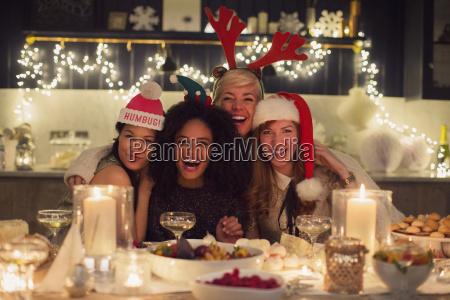 portrait enthusiastic friends enjoying christmas dinner