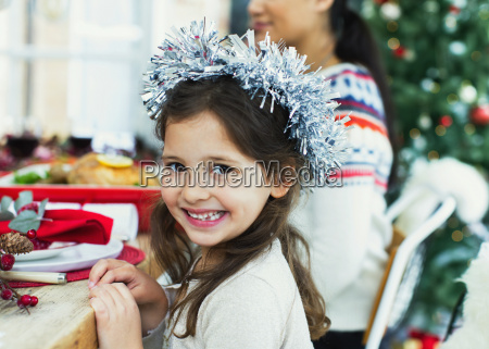 portrait enthusiastic girl wearing wreath at