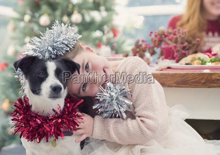 portrait smiling girl hugging dog with