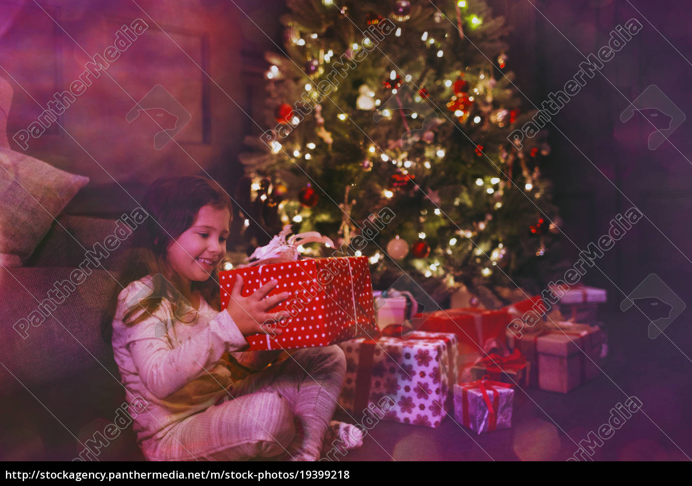 excited, girl, holding, gift, next, to - 19399218