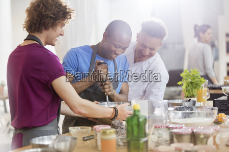 chef teacher and students using hand