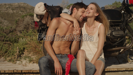 affectionate young couple hugging and laughing
