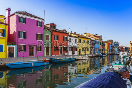 multi colored houses and boats on