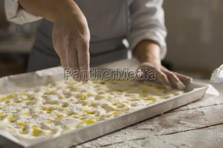 baker preparing gluten free dough for