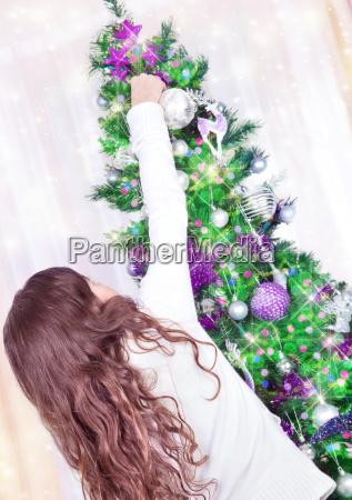 beautiful girl near christmas tree
