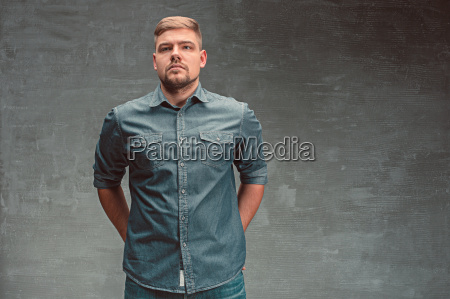 portrait of serious man standing on