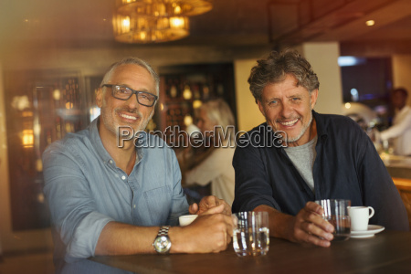 portrait smiling men drinking coffee and