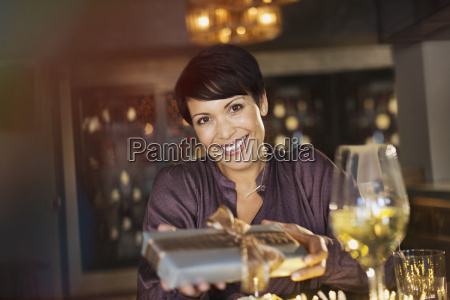 portrait smiling woman giving gift in