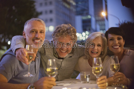 portrait smiling couples drinking white wine