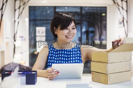 saleswoman in a shop selling edo