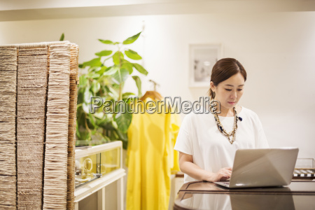 woman working in a fashion boutique
