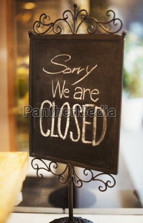 sorry were closed sign in a