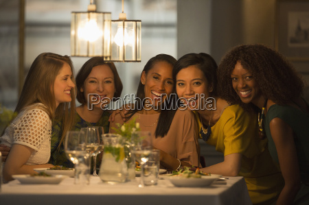 portrait smiling women friends dining at